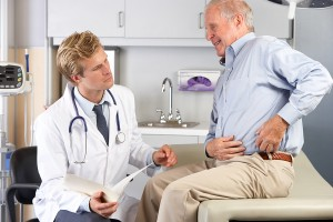 bigstock-Doctor-Examining-Male-Patient--41853457